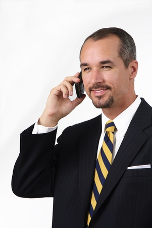 smiling business man in yellow tie on cell phone