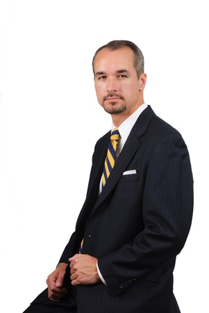 portrait of a business man wearing a dark pinstriped suit
