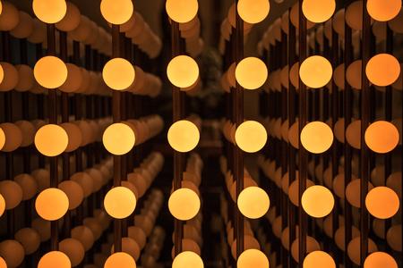 Pattern light bulb background in the shape of a cube. Stok Fotoğraf