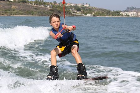boater: Young boy wake Boarding