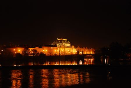 Prague National Theatre at night from River view