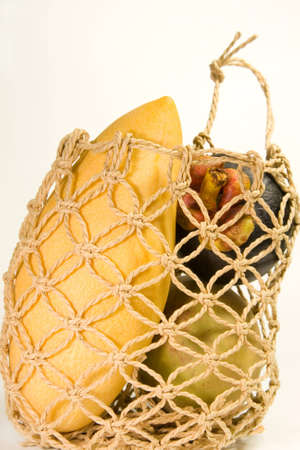 An exotic macrame basket of exotic fruit