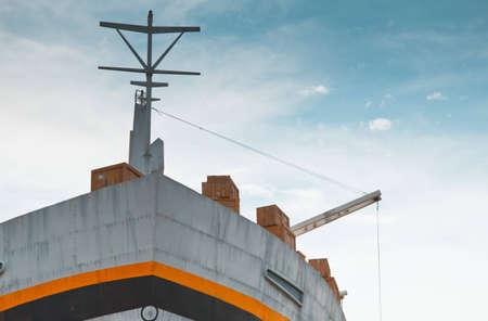 threatens: Loading of a cargo ship as the overcast sky threatens heavy rain