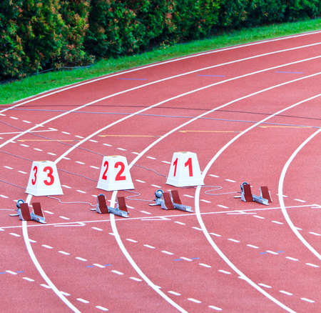 Lanes 1 through 3 equiped with starting blocks for the 100m dash Stock Photo