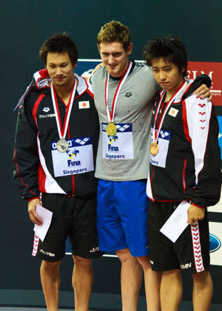 Singapore - Oct. 17: Gold medalist C. Van der Burgh (RSA), silver medalist Naoya Tomita (JPN), bronze medalist Kazuki Otsuki (JPN) for the 100m breaststroke event at the 2010 Fina Swimming World Cup