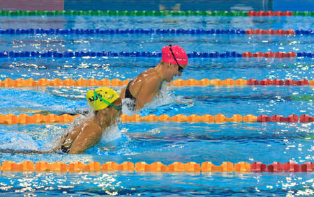 individual sport: Julia Smit, in the pink cap wins the 200m IM event by holding off Kotuku Ngawati of Australia. Editorial