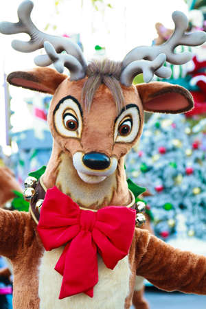 A festive reindeer requesting a hug from participants of the festivities