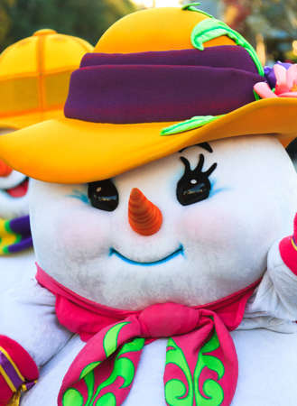 A snow woman joins the festivities of a year end celebration