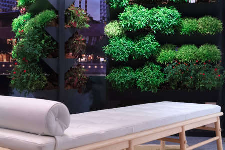 A self made balcony garden with a massage sofa to relax on and take in the view
