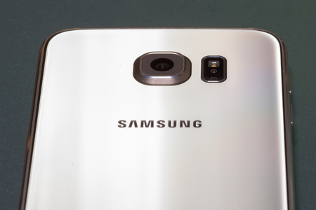 Close up of Samsung Galaxy S6 64gb gold platinum edition rear camera Stock Photo - 53810990