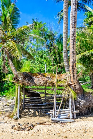A makeshift shelter on the beach of a tropical island. Stock Photo - 62914458