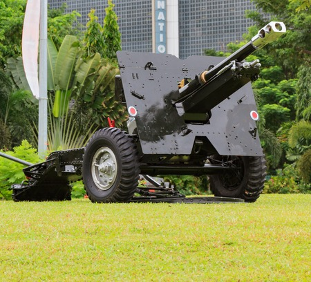 calibre: Brand new looking artillery cannon on display and presentation.