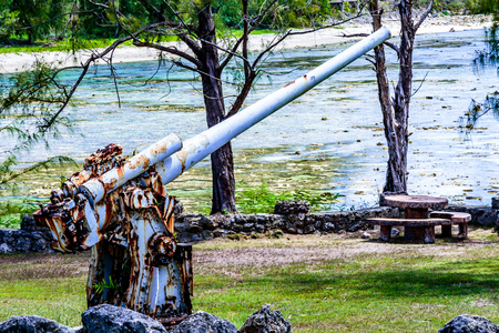 A rusty world war two anti aircraft cannon on display in a public park. Stock Photo - 64068036