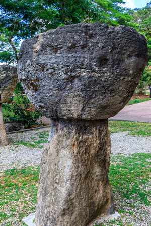 Close up of a latte stone, a building support used and built by the ancient Chamorro people. Stock Photo - 64067446