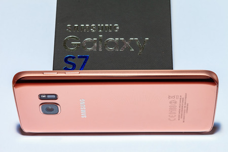Rose gold colored Samsung Galaxy S7 mobile phone. Stock Photo - 61976839