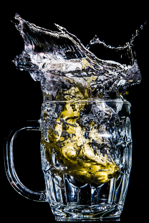 Artistic splash of a banana created after being dropped into a clear goblet. Stock Photo
