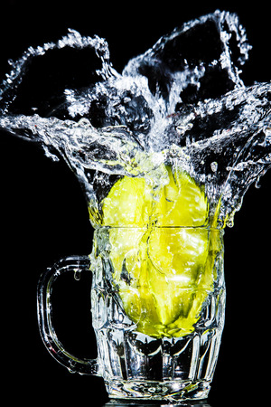Artistic splash of a star fruit created after being dropped into a clear goblet. Stock Photo