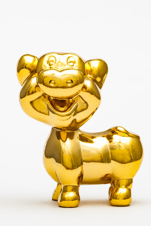 Golden figurine of the chinese zodiac sign of the pig.