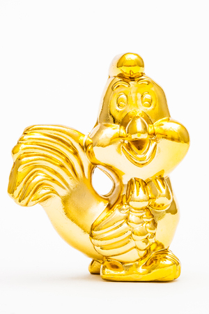 Golden figurine of the chinese zodiac sign of the rooster.