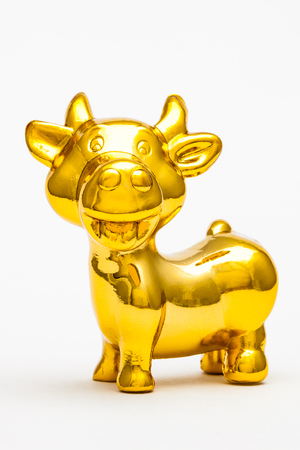 Golden figurine of the chinese zodiac sign of the cow. Stock Photo - 76996305