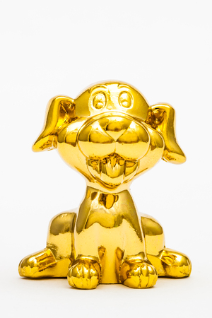 Golden figurine of the chinese zodiac sign of the dog.