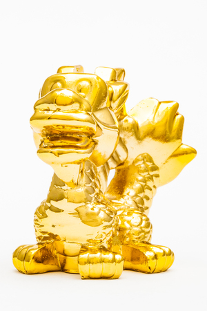 Golden figurine of the chinese zodiac sign of the dragon. Stock Photo - 76996307
