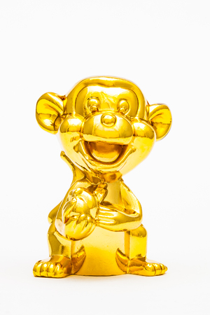 Golden figurine of the chinese zodiac sign of the monkey. Stock Photo - 76996306