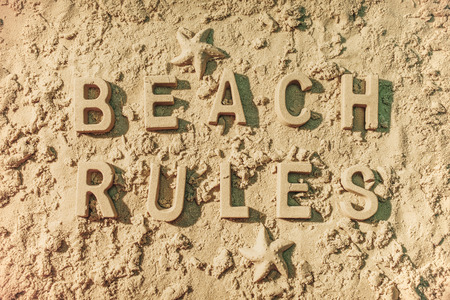 Beach rules message in the sand. Stock Photo