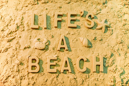 Lifes a beach message in the sand. Stock Photo