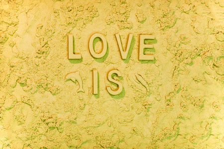 Love is the beach message in the sand.