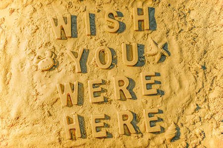 Wish you were here in the sand. Stock Photo