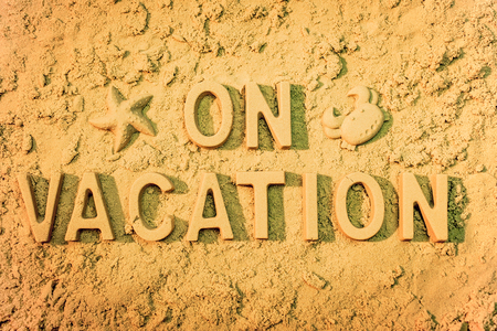 On vacation message in the sand. Stock Photo
