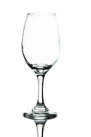 A single wine glass isolated on white with a reflection.