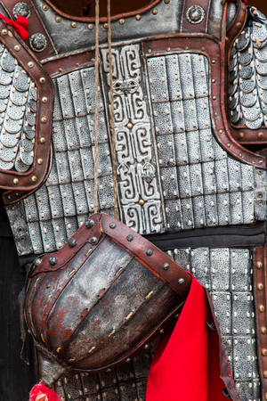 Close up of a rusting ancient asian suit of armour.