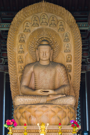 Carved wooden Buddha Sculpture housed in a temple dating back to the Ming Dynasty