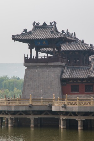 Centuries old, ancient chinese watchtower on a lake