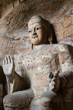 Giant stone Buddha scultpure in one of the main caves at the Yungang Grottos. Stock Photo