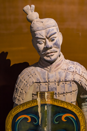 Close up of terracotta warrior holding a wooden shield.