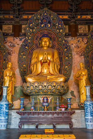 Giant golden Buddha statues housed in the Huayan Monastery. Stock Photo