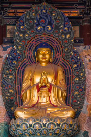 Giant golden Buddha statue