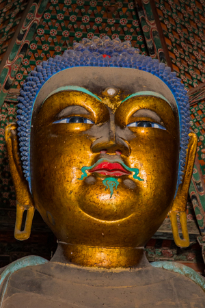 Close up of an 11m high statue of a golden Sakyamuni Buddha