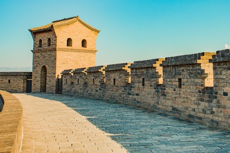Brick guard house atop Pingyao ancient citys wall at dusk Stock Photo