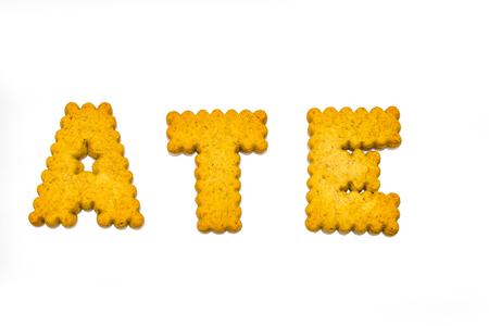 Designer, alphabet cookies arranged to spell words.