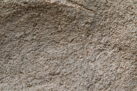 Close up of a wall made of earth revealing its texture.