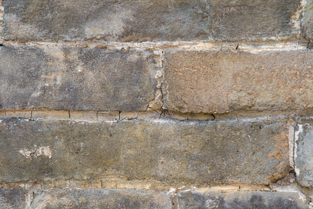 Close up of an old, crumblingbrick wall revealing its scratched surface Stock Photo