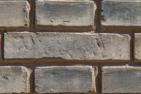 Close up of an old gray brick wall revealing its scratched surface Stock Photo