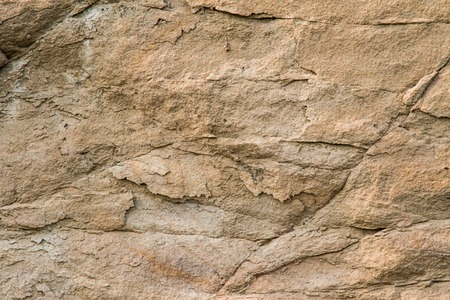 Close up of a sandstone wall revealing its texture