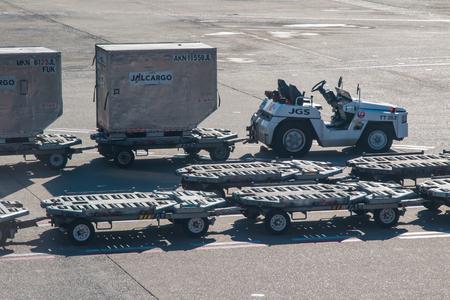 Japan Airlines cargo trolley on standby loaded with containers