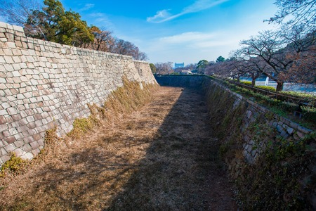 A section of Osaka Castles moat all dried up in winter.