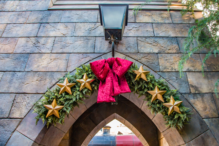 A festive decorated entrance archway to the railway station